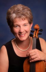 Carol Laube is an assistant baseball coach at Galena. She also plays violin with the Reno Philharmonic orchestra.