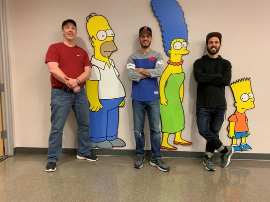 """From left, Norm Auble, a Bergen, Genesee County, native, and Mike Battle and his brother Matt, who grew up in Honeoye Falls, all work on """"The Simpsons."""""""
