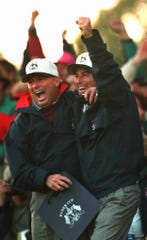 American team caption Lanny Wadkins (left) and Curtis Strange celebrate after Corey Pavin chipped in to win the 18th hole and the match Saturday afternoon.