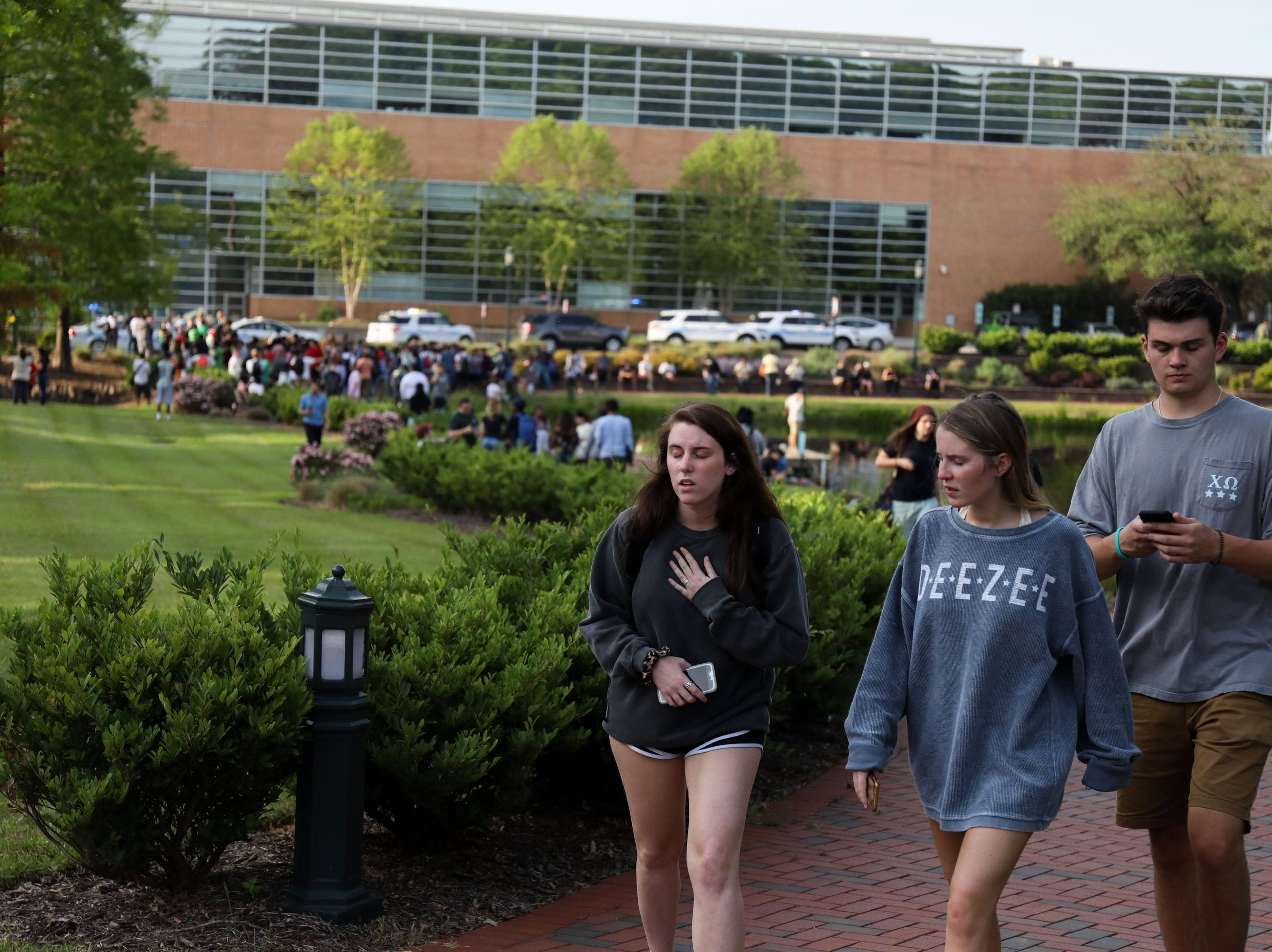 Students and faculty file out of buildings during a lockdown after a shooting on the campus of University of North Carolina Charlotte in University City, Charlotte, on April 30, 2019. - Six people were shot, two of them died on the University of North Carolina Charlotte campus. One person was taken into custody, according to police sources.