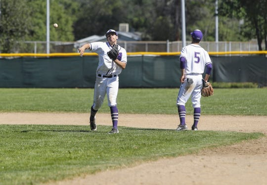Shasta High shortstop Isaiah Pena warms up between innings in a game against Pleasant Valley on Tuesday, April 30.