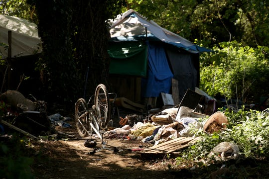 Signs have been posted throughout a homeless camp near Wallace Marine Park stating personal property must be removed or it will be taken by the landowner and its designated agent starting May 7. Photographed in West Salem on April 29, 2019.