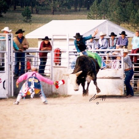 Halverson rides a bull during a rodeo in 1997. He competed in the sport during and after he was in the Army.