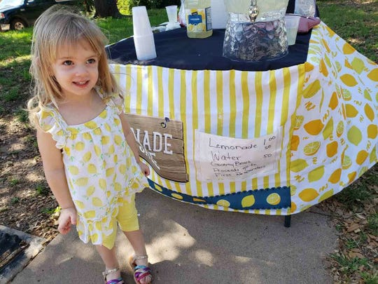 Harley Ratliff looking motivated after earning $700 with her lemonade stand Sunday, April 28, 2019.
