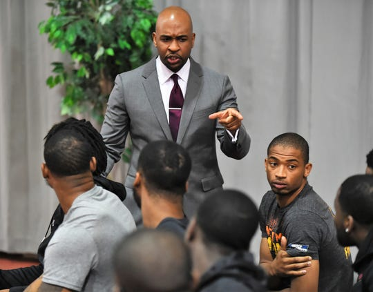 UMES basketball coach Jason Crafton speaks with members of his team following an introductory press conference on Tuesday, April 30, 2019.
