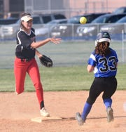 James M. Bennett shortstop Olivia Owens goes for the double play against Stephen Decatur on Tuesday, April 30, 2019.