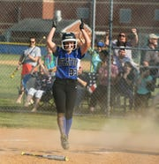 Stephen Decatur's Abby Wesche celebrates after scoring the game-winning run against James M. Bennett on Tuesday, April 30, 2019.
