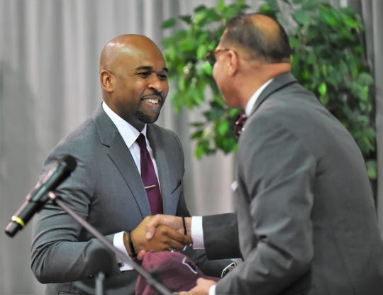 Jason Crafton is congratulated by UMES athletic director Keith Davidson on Tuesday, April 30, 2019.