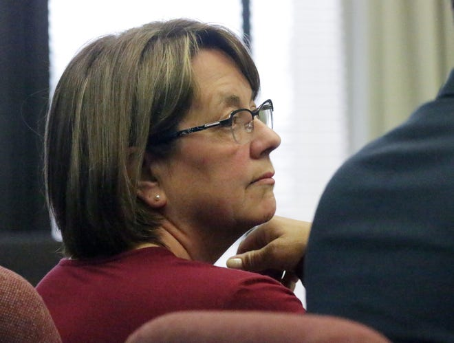 Donna Larue sits in Sheboygan County Circuit Court, Branch 3, Tuesday, April 30, 2019, in Sheboygan, Wis. Larue is accused of stealing $500,000 from St. Vincent de Paul over a 10-year period.