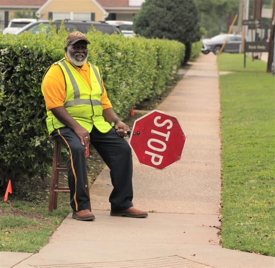 Monday, Earl Speed waited to aid St. Joseph Catholic School students across a residential neighborhood road. The Shreveport Police Department pays the salaries of some private school crossing guards.