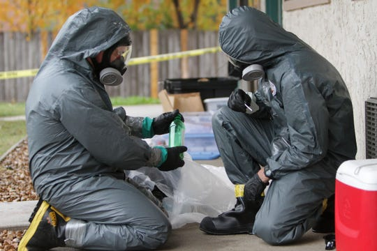 In this 2013 file photo, narcotics officers test a substance found in a bottle at an apparent meth lab found at Motel 6 on N. Glenstone.