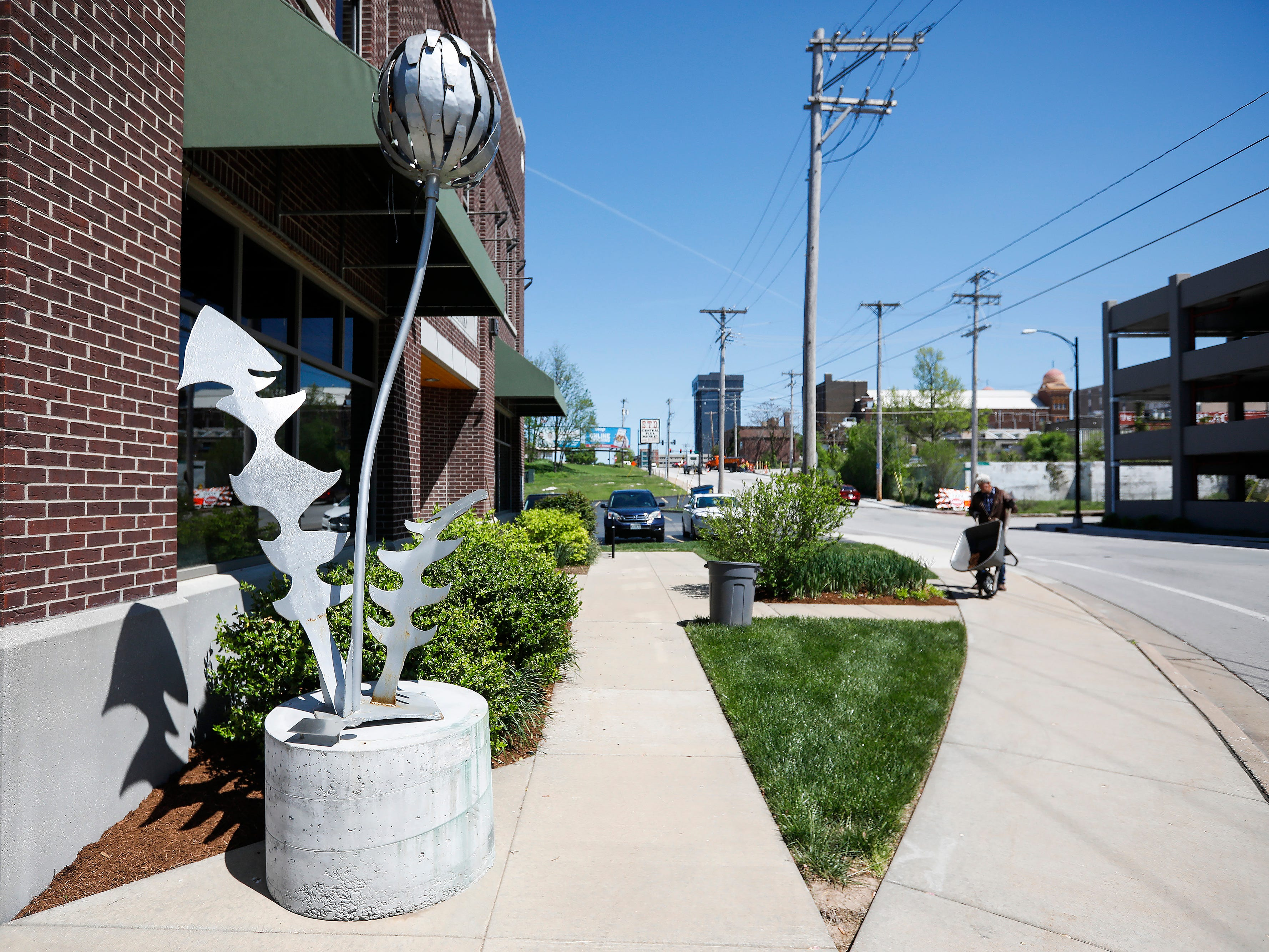 """Dandelion"" by Joe & Terry Malesky is located in front of the Community Foundation of the Ozarks on Trafficway."