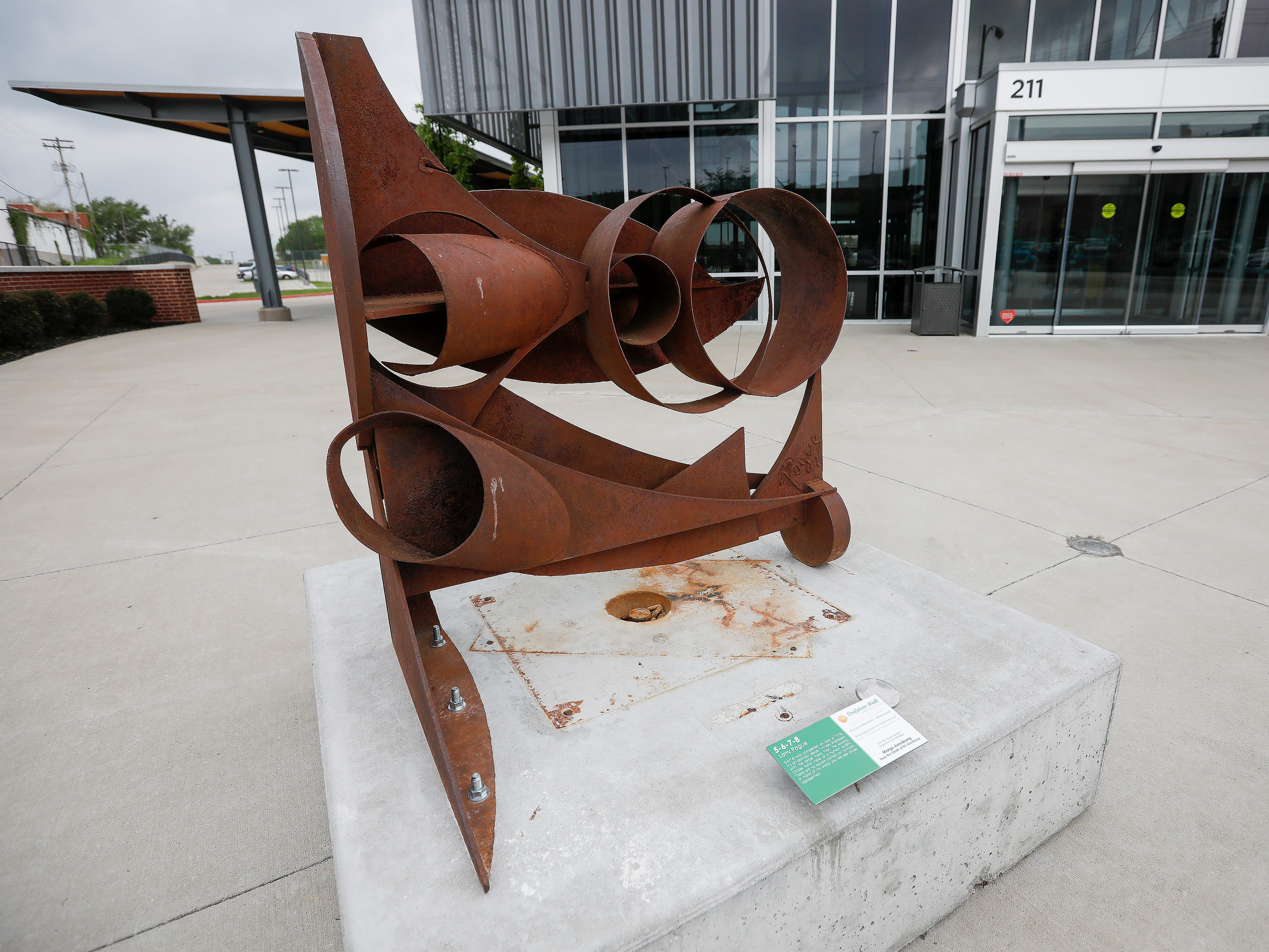 """5-6-7-8"" by Larry Pogue is located on Main Avenue in front of the CU Bus Transfer Station."