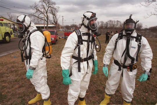 This is a 1998 News-Leader file photo. Drug enforcement agents wait for fumes to be ventilated from a house before searching it for evidence of a meth lab.