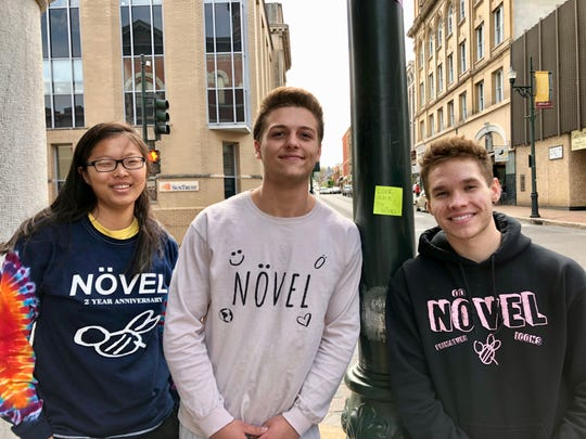 Kara Wright, Clayton Duke and Karson Wright posted positive notes downtown as part of Növel Day on April 29, 2019.