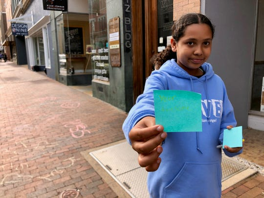 Saraiah Lassiter posted positive notes downtown as part of Növel Day on April 29, 2019.