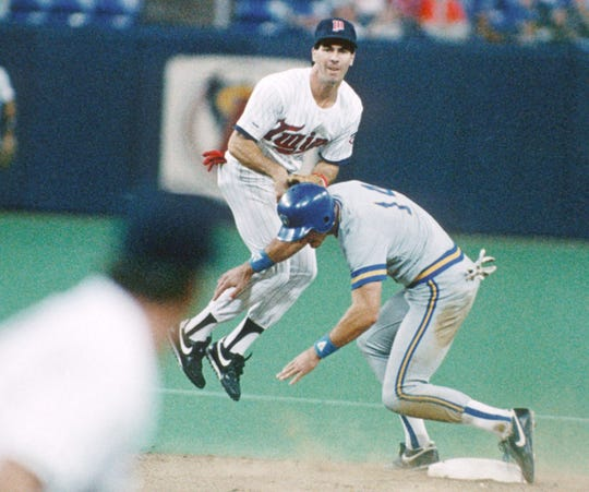 Former Twin Steve Lombardozzi attempts to turn a double play against the Milwaukee Brewers in 1987 at the Metrodome. The runner is Jim Paciorek. The Twins won the  1987 World Series.
