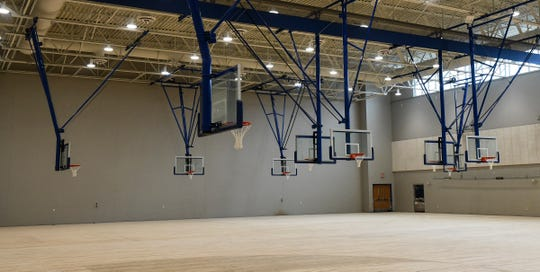 Baskets hang from the ceiling over newly-installed wood flooring in the main gymnasium space Tuesday, April 30, at the new Sartell High School.
