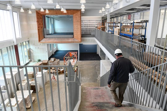 Superintendent Jeff Schwiebert walks down a stairway in one of three learning neighborhoods at Sartell High School during a tour of the facility Tuesday, April 30, in Sartell. The neighborhoods are named Watab, Pines and Meadows to reflect the area's geography and agricultural history.
