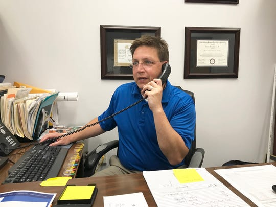 Tallahassee Community College athletics director Rob Chaney works the phone discussing the women's basketball coaching vacancy. He hopes to fill the position by the end of May.