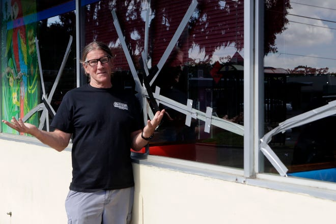 Mike Ferrara, owner of Cabo's Island Grill and Bar, stands outside the restaurant, where a customer smashed large storefront windows Sunday night.