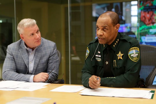 Sheriff Walt McNeil, right, discusses the qualifications former Leon County Sheriff's Office Chief Steve Harrelson for the position of director of the Consolidation Dispatch Agency with Vince Long, left, and other county officials Tuesday, April 30, 2019.
