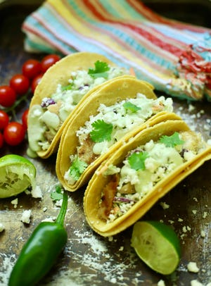 Grilled Fish Tacos with Spicy Slaw and Avocado Crema is full of chargrilled fish, coleslaw and avocado crema.