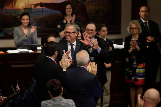 Former Governor Jeb Bush is introduced on the floor of the House of Representatives just before the body voted to approve a Senate bill to allow more students to use taxpayer-funded vouchers to attend private schools.