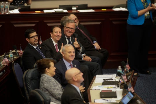 Senate President Bill Galvano and former Governor Jeb Bush give a thumbs up from the floor of the House of Representatives just before the body voted to approve a Senate bill to allow more students to use taxpayer-funded vouchers to attend private schools.