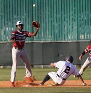 Franklin County shortstop Javon Pride waits on a throw while Wakulla's Joseph Pierini steals second as Wakulla beat Franklin County 8-0 on Monday, April 29, 2019.