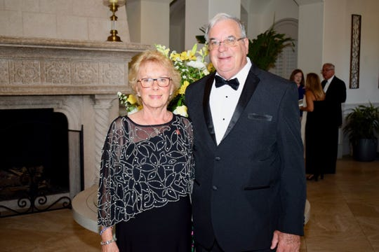 """Michelle Dale, left, president of the Indian River County Chapter of the American Gold Star Mothers, and husband Ken Dale, U.S. Army,  and Acting Director of Operations and Second Vice President of the Veterans Council at the """"Stars &Stripes Spectacular Gala."""""""