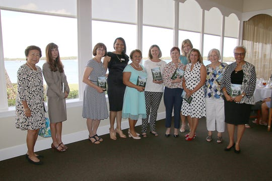 Nancy Wong, left, Elizabeth Barbella, Ruth Stromak, Angela Hayle, Patricia Garcia King, Linda Chastain, Debbie Butler, Carrie Morgridge, Lisa Floyd, Cris Adams and Bunny Webb at Impact 100 St. Lucie's inaugural grant award ceremony at Pelican Yacht Club in Fort Pierce.
