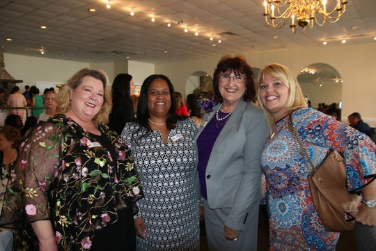 Kimberly Eardley, left, Cecelia Escorbore, Kathryn Hensley and Christine Iannotti at Impact 100 St. Lucie's inaugural grant award ceremony at Pelican Yacht Club in Fort Pierce.