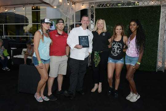 Big Brothers Big Sisters CEO Stacey Watson-Mesley, center, with People's Choice Award first-place winners Cobb's Landing, from left, Tara Post, Chris Dumont, Chef Dave Gould, Kim Uranga and Keanna Mueller.