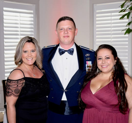 "Enjoying the ""Stars & Stripes Spectacular Gala"" are, from left, Liz Scheidel and her husband, Air Force Maj. Matt Scheidel, treasurer of the Veterans Council, along with Alexandria Huff, development coordinator of the Veterans Council of Indian River County."