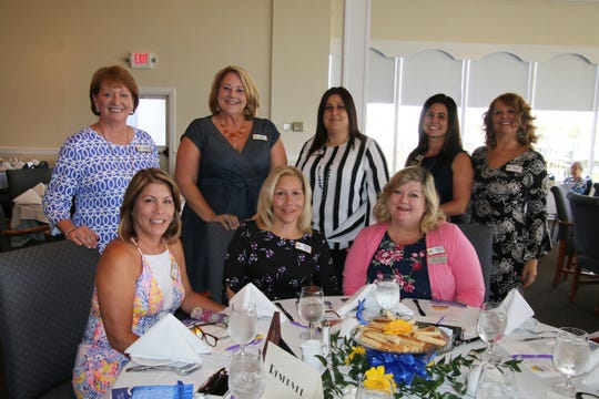 Carol Adams, seated, left, Penny Morin and Theresa Vazquez, with, standing, Eileen McCormick, Terri Sloan-Bartz, Carissa Zerga, Dana McSweeney, Vanessa Farnes at Impact 100 St. Lucie's inaugural grant award ceremony at Pelican Yacht Clubin Fort Pierce.