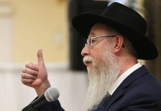 Rabbi Yisrael Greenberg talks about how we are all unique like our thumbprints Monday, April 29, at Chabad Lubavitch  in El Paso. People gathered at Chabad Lubavitch to pray for those impacted by the Chabad of Poway shooting in California.