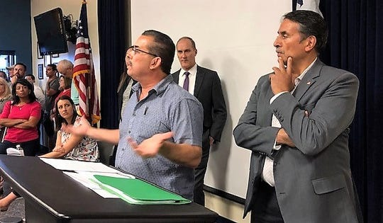 El Paso businessman Andy Dominguez tells Vista Hills homeowners at an April 29 meeting that he wants to get investors to redevelop the Vista Hills clubhouse to help generate money to save the 161-acre golf course in East El Paso. City Rep. Henry Rivera, right, listens along with other city officials.