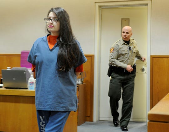 Mayra Chavez walks into the courtroom from her holding cell Tuesday in Ventura County Superior Court. In back is TJ De Salvo, sheriff's deputy. Chavez was sentenced for the death of her daughter and for lying to authorities about what happened to the girl.