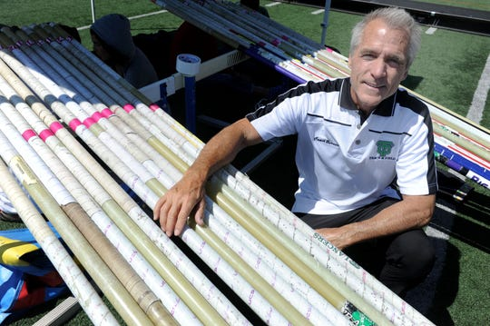 Thousand Oaks High pole vault coach Kevin Burnett has a collection of 70-plus pole vaults. After some 40 years after competing in the pole vault in high school in Akron, Ohio, the 65-year-old Burnett is a Masters-level competitor and ranks No. 5 in the world in his age group.