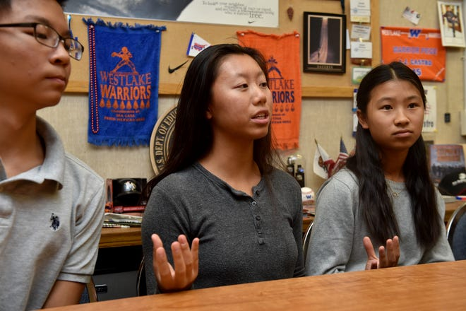 Bethany Tong talks with a reporter about Collegae, a student-run company that aims to connect graduating high school seniors with college students for networking and advice. Tong is one of the five Westlake High School students who founded the business earlier this year.