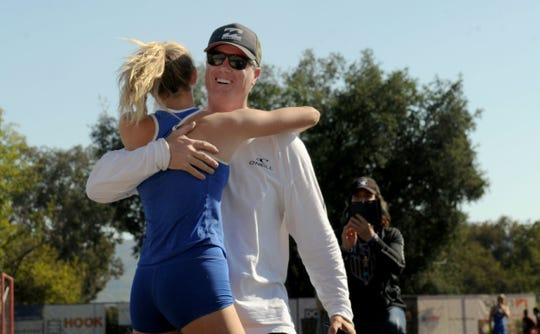 Westlake High sophomore Paige Sommers gets a hug from her father, John, after clearing 13 feet, 6 inches to break her own Ventura County record in the girls pole vault at the Marmonte League Track and Field Championships on April 26. John was an accomplished pole vaulter and is now the coach of one of the best female pole vaulters in the state.