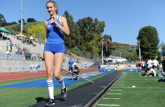 """Westlake High sophomore Paige Sommers goes to the starting line before competing in the pole vault at the Marmonte League Track and Field Championships on April 26. Sommers broke her own county record by clearing 13 feet, 6 inches. She says """"(pole vault) is hard. There's so many steps to learn, so much to master. I've never had a perfect vault. I'm not sure if I ever will. But it's always something to go for."""""""