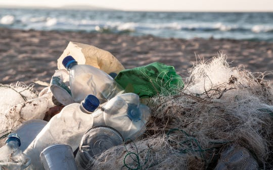 Beach pollution. Plastic bottles and other trash on beach