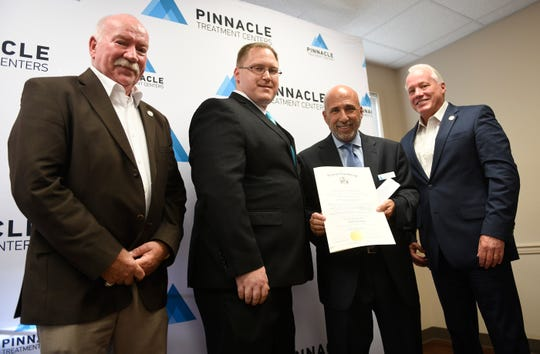 From left to right, Assemblyman Bruce Land, Senator Bob Andrzejczak, Pinnacle Treatment Centers C.E.O. Joe Pritchard and Assemblyman Matt Milam pose for a photo during a open house for a new opioid treatment center in Vineland on Tuesday, April 30, 2019.