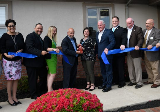 Chief Executive Officer Joe Pritchard and Executive Director Stephanie Lamancusa cut the ribbon for Pinnacle Treatment Center's Vineland location on Tuesday, April 30, 2019.