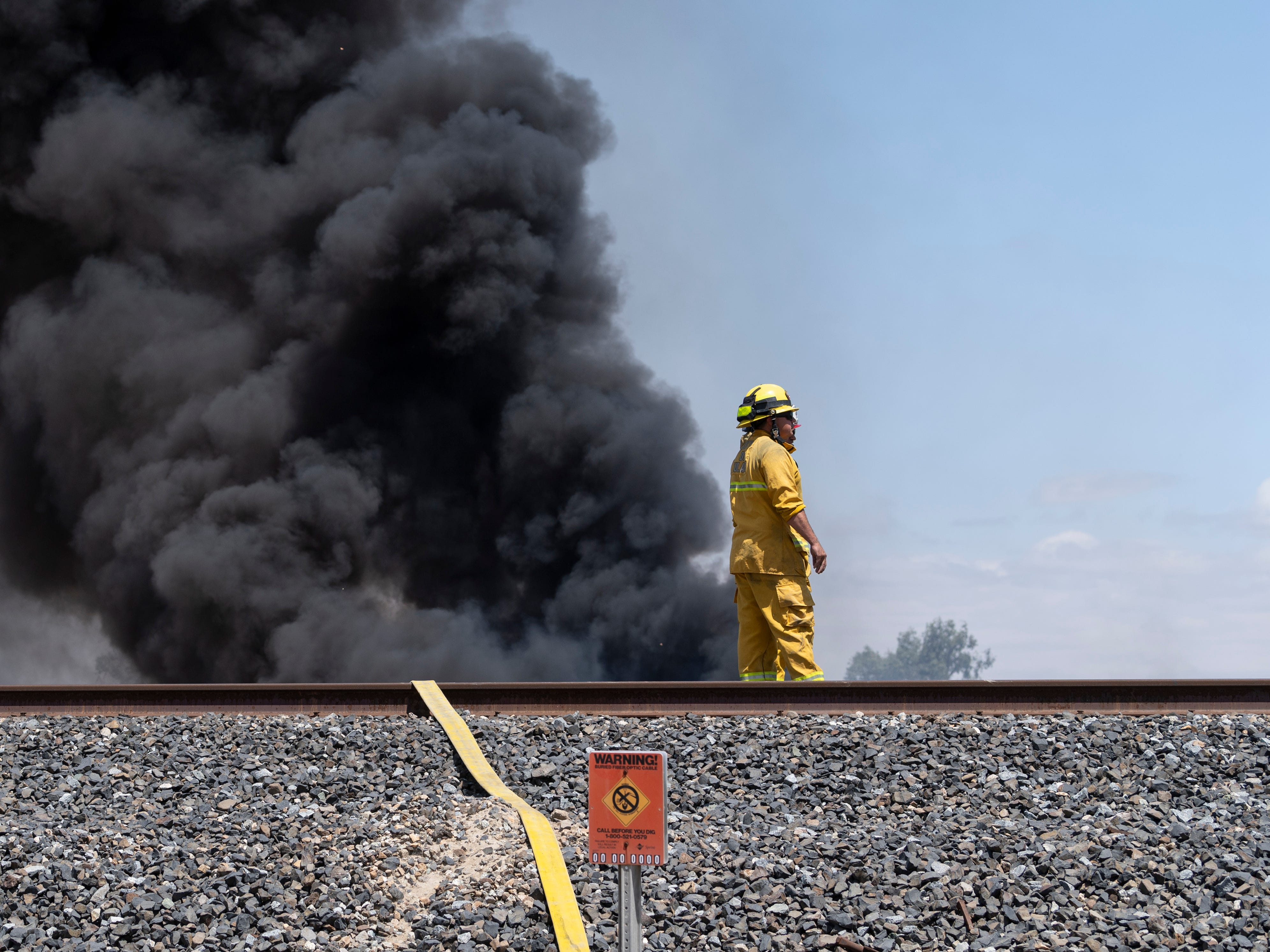 Tulare County firefighter assisted Tulare City Fire Department with a grass fire that ignited tires behind a business on K Street just south of Paige Avenue on Tuesday, April 30, 2019.