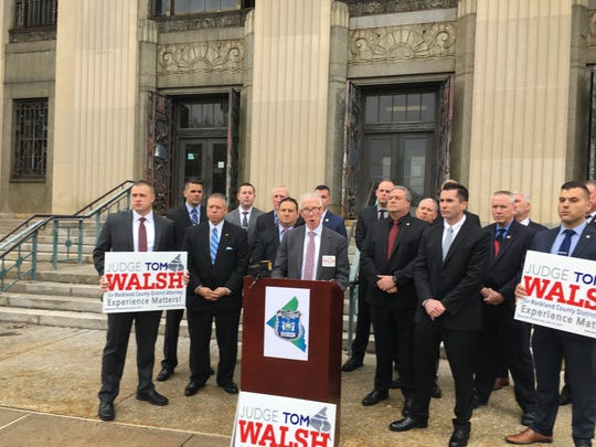 Thomas Walsh accepts Rockland PBA endorsement for district attorney outside the County Courthouse.