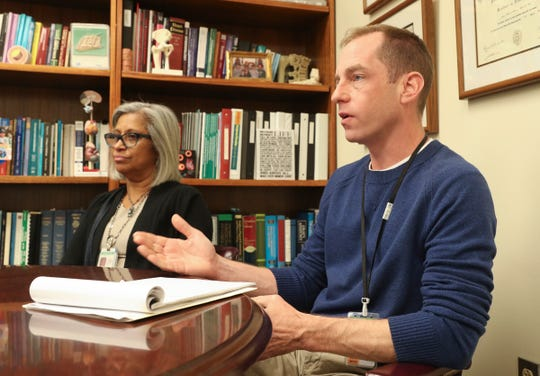 Maria Souto, Coordinator of Communicable Disease Programs, left, and Kevin McKay, Director of Epidemiology discuss the process of investigating the measles outbreak at the Rockland County Dept. of Health office in Pomona on Tuesday, April 30, 2019.