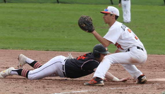 Justin DiSavino (7) of White Plains misses the tag on Mamaroneck's Andrew Antinelli (24) during the first annual Richard W. Kittle Memorial baseball game at White Plains High School April 29, 2019. Mamaroneck defeats White Plains 3-1 the first Kittle Cup in honor of former coach and umpire Dick Kittle, who passed away in 2017.